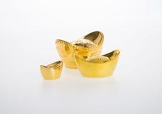 Oro o símbolos chinos del medio del lingote del oro de la riqueza y de la prosperidad foto de archivo libre de regalías