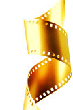 Oro película de 35 milímetros Fotografía de archivo libre de regalías