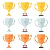Oro, plata, trofeo de bronce en los iconos planos fijados Imagen de archivo libre de regalías