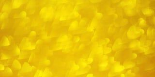 Oro reluciente, fondo brillante con los corazones del amor de la forma del bokeh foto de archivo libre de regalías