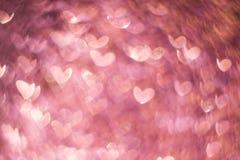 Oro rosado, bokeh color de rosa rosado, fondo ligero abstracto del corazón, día de San Valentín, mujeres día, contexto romántico  imagenes de archivo