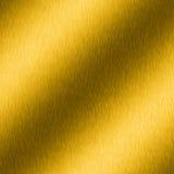 Oro spazzolato con i punti culminanti Fotografia Stock