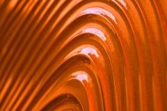 Oro; Struttura arancio della parete, modello astratto, fondo moderno dell'onda e geometrico ondulato di strato di sovrapposizione fotografia stock libera da diritti