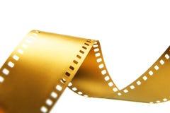 Oro una pellicola da 35 millimetri Fotografia Stock