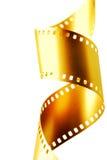 Oro una pellicola da 35 millimetri Fotografia Stock Libera da Diritti
