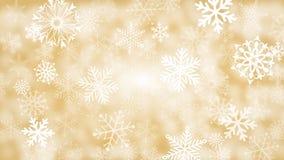 Oro y fondo blanco del copo de nieve Fotos de archivo libres de regalías