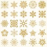 Oro y fondo blanco del copo de nieve Imágenes de archivo libres de regalías