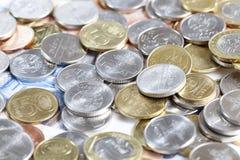 Oro y monedas de plata foto de archivo libre de regalías