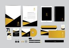 Oro y negro con la plantilla de la identidad corporativa del triángulo Foto de archivo libre de regalías