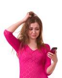 oroa för flickatelefon Arkivfoto