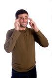 Oroad ung man och lidandehuvudvärk Fotografering för Bildbyråer