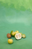 Oroblanco and other green fruits on a green background Stock Photo