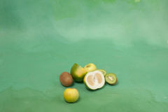Oroblanco and other green fruits on a green background Stock Image