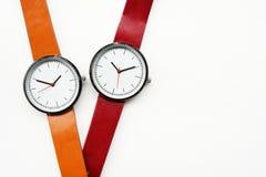 Orologi arancio e rossi Immagini Stock