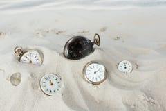 Orologi da tasca nella sabbia Immagine Stock Libera da Diritti