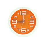 Orologi di parete arancio fotografia stock libera da diritti