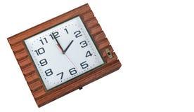 Orologi di parete di legno di marrone di vista superiore su fondo bianco, spazio della copia fotografia stock