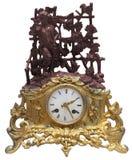 Orologi di tabella dorati antichi isolati con la statuetta immagini stock