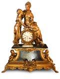 Orologio antico con i figurines Immagini Stock