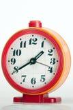 Orologio arancio del briciolo rosso vecchio Immagini Stock
