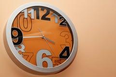 Orologio arancione Fotografie Stock