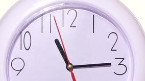 Orologio bianco isolato Fine in su archivi video