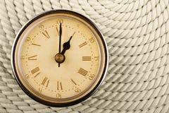 Orologio con i numeri romani. Un'ora. Fotografie Stock