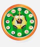 Orologio con il simbolo di gioco del calcio Fotografie Stock Libere da Diritti
