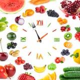Orologio dell'alimento con la frutta e le verdure Immagine Stock