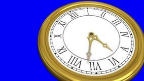 Orologio dell'oro su fondo blu stock footage