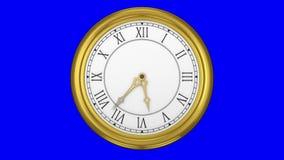Orologio dell'oro su fondo blu video d archivio