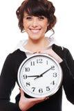 Orologio della holding della donna di affari di smiley Fotografie Stock