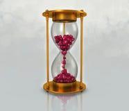 Orologio della sabbia e cuore dentellare Immagini Stock Libere da Diritti