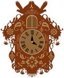 Orologio di cuculo marrone decorato ricco Fotografia Stock