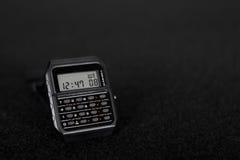 Orologio di Digital con il calcolatore fotografie stock