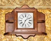 Orologio di legno dell'annata Fotografia Stock
