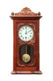 Orologio di parete antico isolato su bianco Immagine Stock
