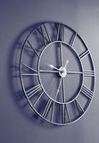 Orologio di parete con i numeri romani Fotografia Stock Libera da Diritti