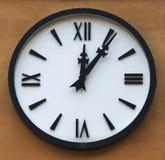Orologio di parete nero Immagine Stock Libera da Diritti