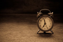 Orologio di rosso di natura morta Fotografia Stock