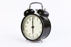 Orologio di tavola classico su un fondo bianco Fotografia Stock Libera da Diritti