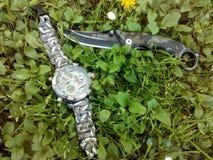 Orologio e coltello Fotografia Stock