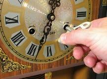Orologio e mano Fotografie Stock Libere da Diritti