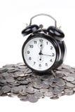 Orologio e soldi Fotografia Stock