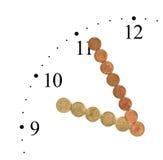 Orologio fatto delle monete dei soldi Immagine Stock