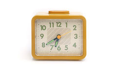 Orologio giallo isolato Fotografie Stock