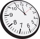 Orologio isolato su priorità bassa bianca Immagini Stock