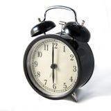Orologio nero d'annata su fondo bianco fotografie stock