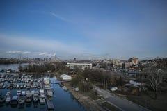 Orologio sopra Belgrado dal ponte del ada fotografia stock libera da diritti