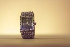 Orologio su un fondo leggero Fotografia Stock